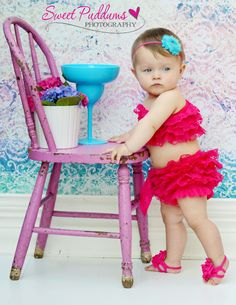 What a perfect photo! She's so cute!    Photo leads to the shop that sells the lace bikini romper.
