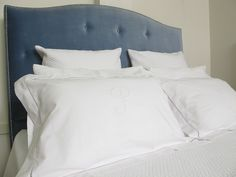 Blue velvet studded bedhead by Judy Porter and hand embroidered lined letter pillow cases...