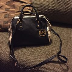 Black and White Michael Kors Purse Has a few pockets on the inside and one discreet one on the outside. Beautifully made purse and its in great shape. No trades. :) measures roughly around 10x8 in. MICHAEL Michael Kors Bags Shoulder Bags