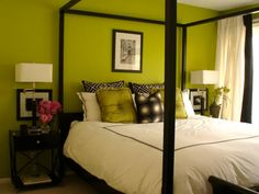 This Eclectic Bedroom has: white bedding green and black pillows green painted walls canopy bed frame black wood night stand black framed art white Lime Green Bedrooms, Bedroom Green, Green Rooms, Bedroom Decor, Green Walls, Bedroom Black, Master Bedroom, Bedroom Ideas, Bedroom Inspiration
