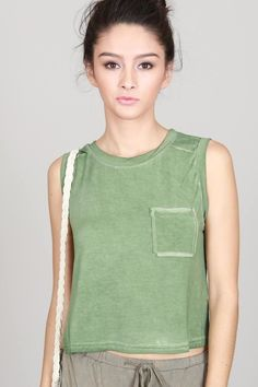 Sleeveless round neck slightly cropped top. *Product is slightly darker in person than on the model*