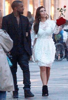 A vision in white! Kim Kardashian wears romantic bridal-inspired dress as Kanye West buys her a red rose in Venice for her birthday