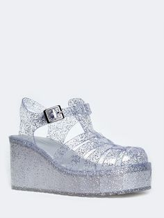 - These jelly sandals can't be missed with it's cage design and platform sole! - Chunky flatform sandals have a buckle closure on the side with a glittery upper that will definitely get you noticed. -