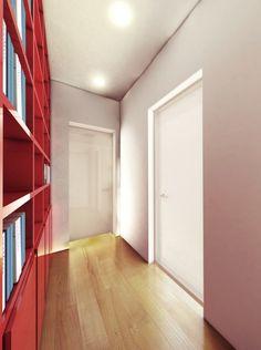 """Il corridoio """"si illumina"""" grazie alle porte con battente in vetro che lasciano filtrare la luce dalle stanze allo spazio di passaggio. E con una finitura laccata si preserva ugualmente la privacy degli ambienti. In più, grazie agli stipiti slim l'effetto è accentuato."""