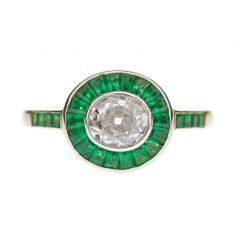 antique cushion cut ring with emerald halo
