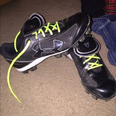 Under Armor softball cleats. Softball cleats worn once (to a practice), the bottoms are a bit dirty, very cleanable! Comes with all the multiple colorful shoe laces to interchange! Under Armour Shoes Athletic Shoes