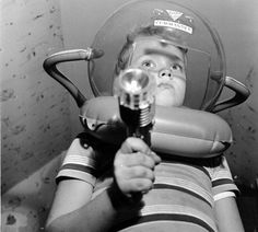 This kid's got both the Space Patrol helmet and the Marx Space Patrol Flashlight Gun.