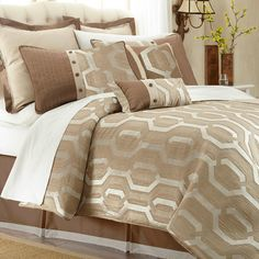 Bring a pop of pattern to your master suite or guest room with this inviting comforter set, showcasing a linked trellis motif in tan and brown hues....