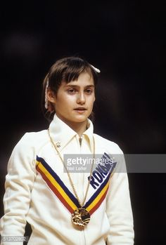 Closeup of Romania Nadia Comaneci victorious with gold medal after winning Women's event at Montreal Forum. Neil Leifer X20678 R81 F34 )