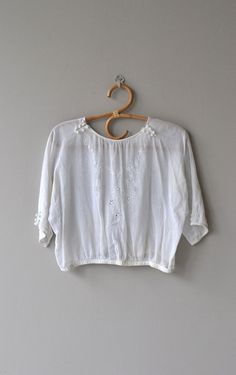 Antique 1920s white cotton batiste blouse with gathered neckline embellished with crochet false buttons, white floral embroidery, 3/4 sleeves with