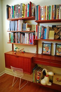 love the idea of off set wood shelving with a desk underneath. would have to fit two boys doing homework at the same time. eek!