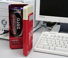USB Mini Fridge holds and chills one can at a time powered by USB from computer.
