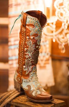 """Double D Ranch by LaneAmmunition boot.  Premium brown and turquoise leather  Heavily embellished  2"""" Cowboy heel  Studs and crosses  Corset collar back"""