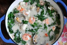 White Seafood Cioppino - seafood in white wine and coconut milk with kale. Dairy free.
