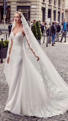 EDDY K. MILANO bridal 2017 sleeveless spaghetti straps lace bodice sheath wedding dress (md201) mv overskirt train veil #bridal #wedding #weddingdress #weddinggown #bridalgown #dreamgown #dreamdress #engaged #inspiration #bridalinspiration #weddinginspiration #weddingdresses