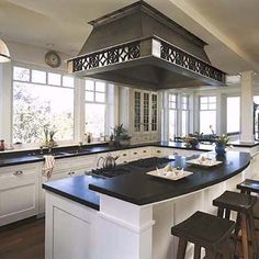 black counters, windows, cabinets, sink placement, cooktop on island, island should be one level