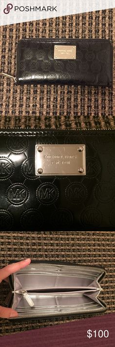 💯Michael Kors JetSet Monogram Black Mirror Wallet 🎉SALE 🎉 Authentic Michael Kors Zip around wallet- includes inside zipper pocket, 8 credit card slots and 4 cash/receipt pockets. Small spot on inside. Michael Kors Bags Wallets