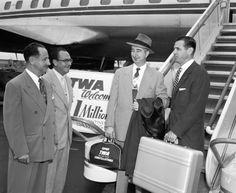 #ThrowbackThursday! A satisfied Zero Halliburton customer is greeted by TWA employees upon arrival in 1954.