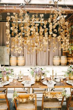 Rustic meets glam with these golden hanging decors over a wooden table