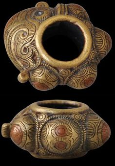 Indonesia | Rare cast brass medicine ring inlaid with copper and iron from the Batak people of North Sumatra. ca. 19th century. A related example is illustrated in Sibeth (2102, p. 124) and another in van Cutsem (2000, p. 179). | Price on request