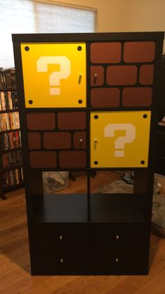 IKEA Kallax shelves with painted inserts for game room