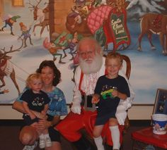 Taken June 2002. This is a picture with me (mom), my son Kyler (in my lap-age 1 1/2 at the time), and Derek (on Santa's lap-age 5). Westfield, Indiana.