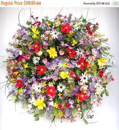 Handcrafted, on a wild birch twig base, this colorful wreath would be perfect between 2 doors or for an apt or condo-nursing home door or any where you want a bright and colorful accent. Lots of different colors in shades of reds, yellows, lavender/purple, whites, pinks, and more. Full of cosmos, wild daisies, wild grasses, ivy stems, pipberry stems, star forsythia, flax greenery, wildflowers, flax grass, berry stems, astible stems, star flowers, blossom blooms, morning glories, 4 feathe...