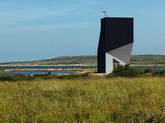 Completed in 2011 in Bay Roberts, Canada. Images by Bent René Synnevåg. The Tower Studio is dramatically situated on a stretch of rocky coastline in Shoal Bay, Fogo Island, Newfoundland. The studio's sculptural silhouette. Costa, Canada, Architecture Photo, Architecture Wallpaper, Contemporary Architecture, Dezeen, Art Studios, That Way, Interior And Exterior