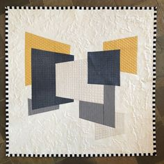 """Titled """"Floating Vertical Planes"""" this Foundation Paper Pieced 62"""" square quilt originally designed via EQ8 and constructed for MQG Riley Blake Spring 2018 Fabric Challenge. Balancing trapezoids, gradient ruler work accents, silk thread, double cotton batting all help to give it a 3 dimensional feel. Intermittent tight FMQ """"brain coral"""" on the perimeter adds to the relief of the featured fabrics and enhances the floating """"clouds"""" illusion."""
