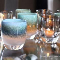 snowy southern cap, cloud curls diffuse, oceans blue beside africa. the blue marble planet is upside down, yet alive in silent black, unmistakably 'home' #gbhome  this december, the glassybaby white light fund is devoted to saving wild african elephants.