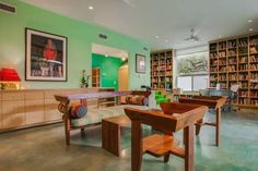 the floors and mint green walls...and bookcases floor to ceiling!!