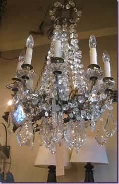 Antique crystal chandelier.  Brown Lighting. I Need it!!! I wants it.