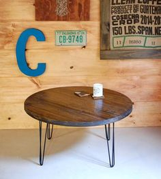 Add the rustic finishing touch to your living space with this reclaimed wood coffee table. Planks of lumber are upcycled and pieced into round shape, sanded velvety smooth and stained in your choice of hue. The coffee table is perched on metal hairpin legs, for industrial, vintage-inspired flair.