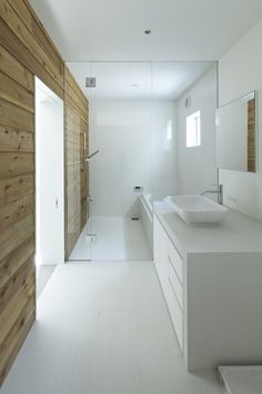 Townhouse in Shimoda is a minimal home located in Kanagawa, Japan, designed by EANA. The home was built for a client that consisted of a married-couple and their dog. A requirement was to secure a parking space in order to allow a large number of people to visit the home without having to struggle to find a parking spot. (14)