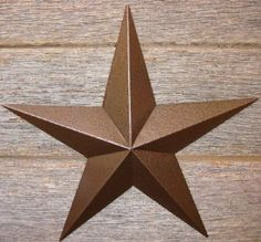 """MADE IN USA  53 Inch Heavy Duty Metal Barn Star Painted Hammered Brown. The Hammered Paint Effect Allows the Star to Look Great in Either a Contemporary or Rustic Theme. This Tin Barn Star Measures Approximately 53"""" From Point to Point (Left to Right). The Barnstar Is Hand Crafted Out of 22 Gauge Galvanized Steel By the Old Order Amish From Central Ohio. This Size Star Will Arrive in 5 Wings, Screws and Nuts. The Top Piece and Has a Hang Tag Spot Welded Across the Back of the Top Tip of the…"""