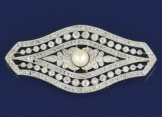 An early 20th century diamond and pearl brooch  The shaped oval openwork panel with central bouton pearl, old-cut diamond foliate panel shoulders and rose and old-cut diamond triple row border, circa 1910