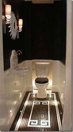 Bling bathroom (although the floor lighting seems like a good idea for night time visits).