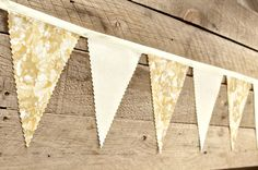 White and Gold  - Vintage Bunting Banner with 12 Flags. $25.00, via Etsy.