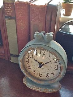 Blue clock with books.