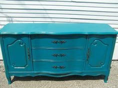 Under TV. Not spending $650 but I love this.   Deep Teal French Provincial Buffet. $650.00, via Etsy.