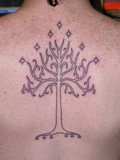 A Lord of the Rings tattoo design of the white tree of Gondor surrounded by stars