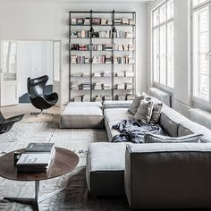 More sofa crushing. The NeoWall Sofa by Living Divani from @spacefurniture features prominently on our radar this month. | Styled by Annabell Kutucu | Photography by Claus Brechenmacher #instadaily #instastyle #instadesign #estliving #sofa #grey #livingdivani #design