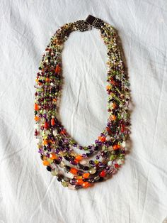 Beaded statement neckpiece This probably has stones on each possible color and lights up the neck like galaxy of stars! This is a heirloom from my mother in law to me!