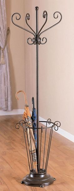 This metal frame umbrella stand coat rack exudes an abundance of Victorian charm & elegance! The rack is finished in deep black, accentuating its appealing wrought iron style scrollwork. Four gracefully curved coat hooks top the tall rack. Wrought Iron Decor, Umbrella Stand, Steel Furniture, Iron Furniture, Coat Rack, Metal, Iron Decor, Metal Furniture, Metal Design