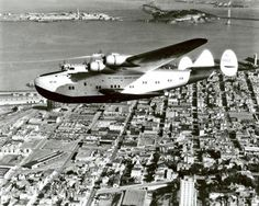 Pan Am Boeing 314 Clipper low over San Francisco.