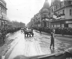 Happy crowds of Frenchmen greet convoys of the US 28th Infantry Division going through the city of Colmar, France, after its liberation. 2/3/45. (US Army Signal Corps Photograph, US National Archives)