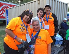 Guest services volunteers from left to right Luz Ramos Michael Ricciutti Kristina Austlid and Fran Back await Pope Francis' parade along the Benjamin Franklin Parkway Saturday September 26 2015. #PVatPope Photo by- @thom_carroll