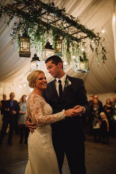 Hanging ladder over dance floor decorated with greens, white hanging blooms and lanterns. Dance Floor Wedding, Wedding Wall, Chic Wedding, Wedding Details, Wedding Reception, Wedding Ideas, Ladder Hanger, Hanging Ladder, Ladder Decor