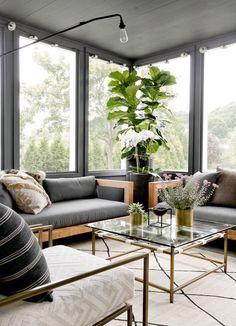 Modern boho sunroom | Photo: Rikki Snyder