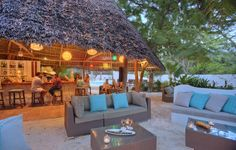 Relax and enjoy a drink or two, while watching the sun set over the ocean.  Zanzibar | Africa | Honeymoon